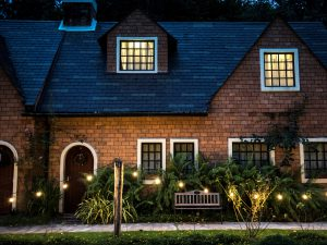 red brick house with exterior lighting