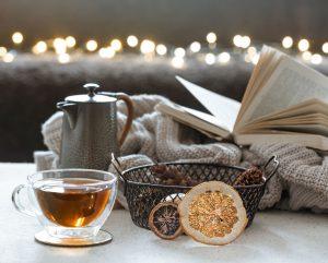 a grouping of tea, mug and blanket